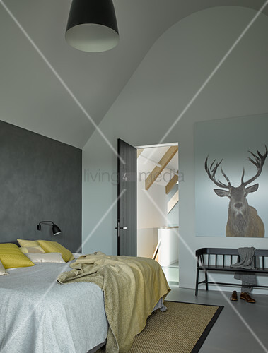Modern bedroom in shades of grey with high ceiling