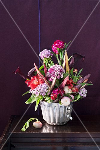 Autumnal bouquet of vegetables and flowers in cake tin