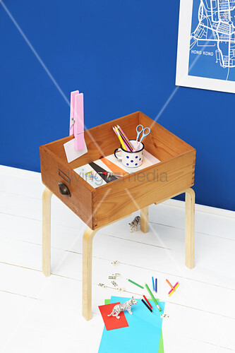 Side table made from old drawer and furniture legs
