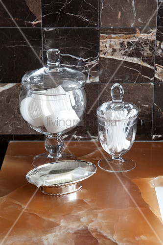 Cosmetics stored in vintage-style sweet jars
