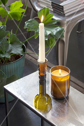 Candlestick and candle lantern made from cut-off wine bottles