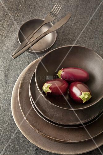 Miniature aubergines in bowl
