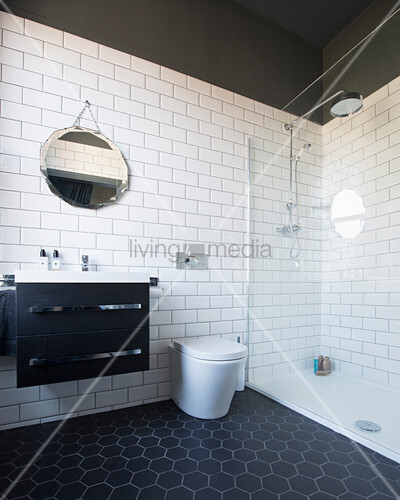 Black-and-white bathroom with hexagonal floor tiles and walk-in shower