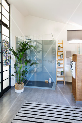 Glass shower cubicle in bathroom