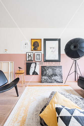 Gallery of pictures on two-tone wall