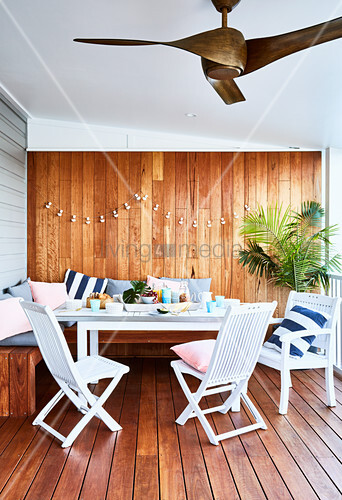 Outdoor furniture on roofed, wood-clad terrace