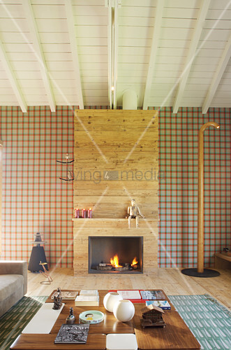 Fireplace and tartan wallpaper in elegant living room