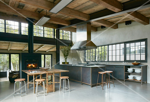Open-plan, industrial-style interior with high ceiling