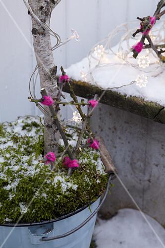 Handmade twig star as festive garden decoration