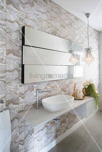 Modern mirror on staggered levels above sink