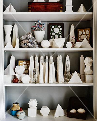 Collection of obelisks and polished stones on shelves