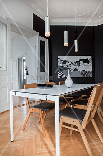 Elegant black-and-white dining room in period apartment