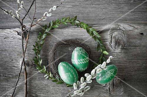 Hand-painted green Easter eggs with box and willow wreaths and pussy willow branches