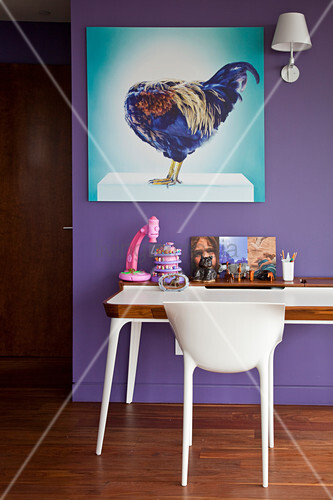 Picture of hen on purple wall above desk