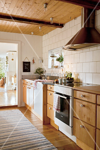 Country-house kitchen with wooden cabinets