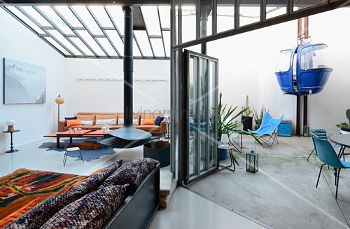Modern loft apartment in former textile factory with cable car