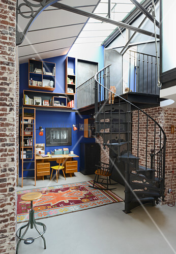 Study in modern loft apartment in former textile factory