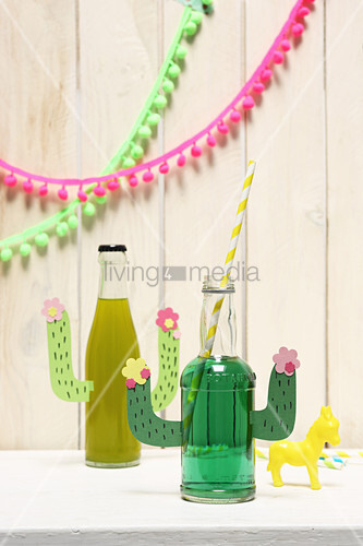 Handmade party decorations: pop bottles with cactus arms