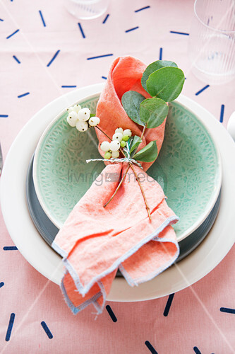 Snowberries, sprig of eucalyptus and napkin on plate