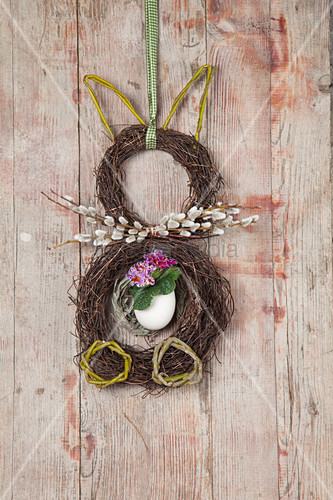 Easter bunny made from two wreaths of maidenhair vine tendrils on wall