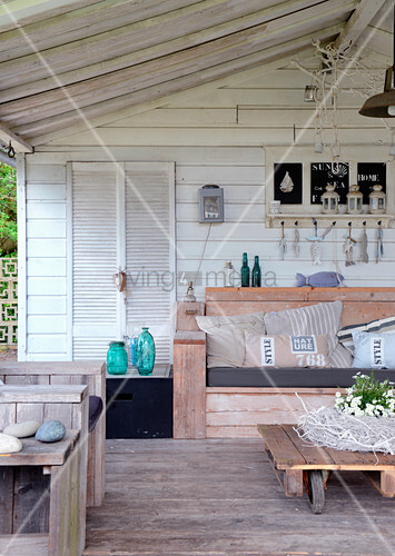 Vintage-style seating area on roofed terrace