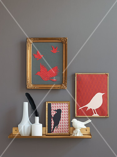 Homemade paper bird silhouettes in picture frames