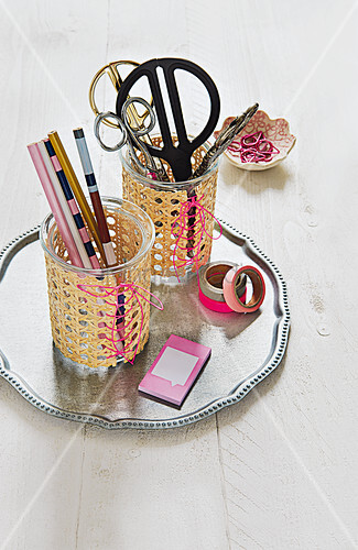 Homemade glass pen pots wrapped in wicker