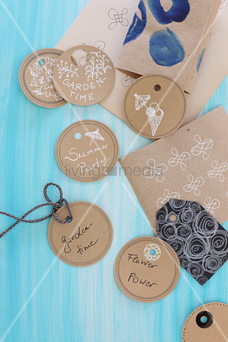 Hand-crafted round tags with summer and garden motifs