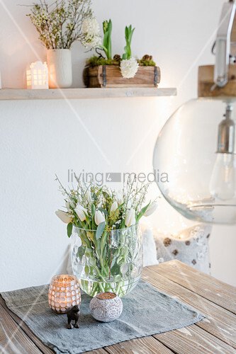Tulips and white broom in glass vase
