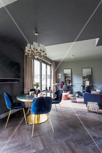 Grey walls and velvet furniture in dark living room