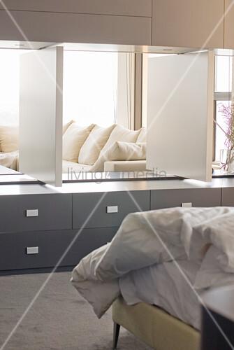 Flexible wall panels between bedroom and living room