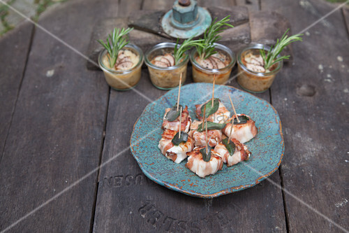 Goat cheese wrapped in bacon and jars of homemade spread
