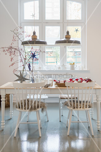 Festive decorations in dining room in pale grey and white