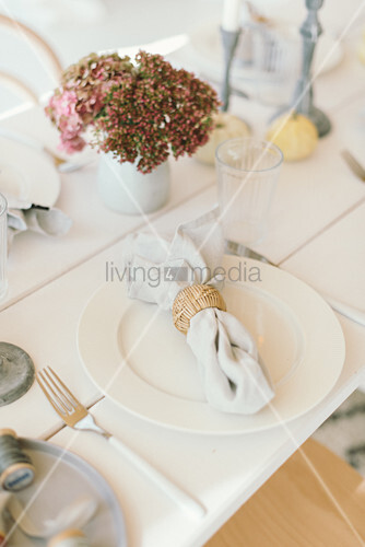 Autumnal arrangement of hydrangeas on table