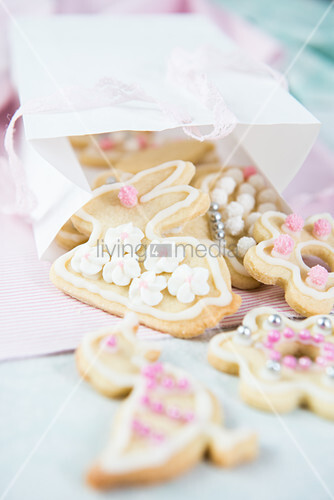Easter biscuits decorated with icing and silver balls