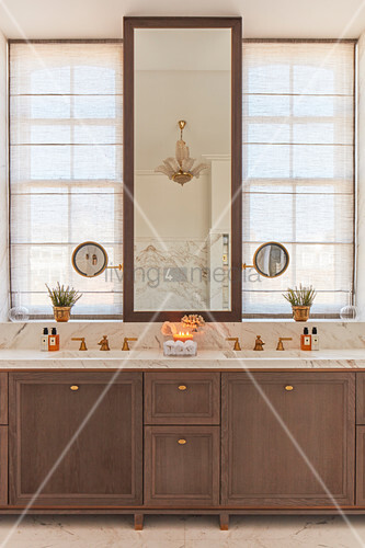 Luxurious bathroom with marble elements and symmetrical fittings