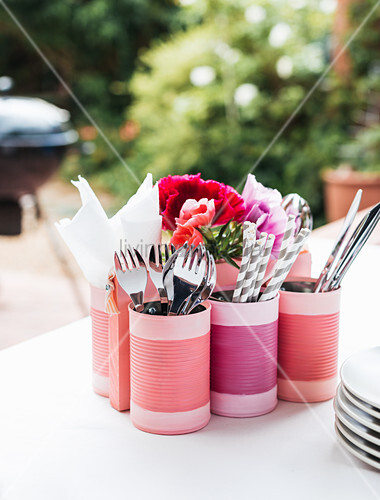Cutlery holders made from tin cans painted pink