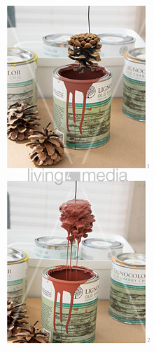 Dipping pine cones in paint