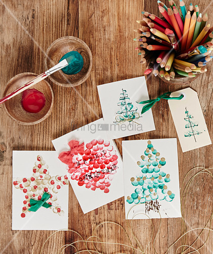 Handmade Christmas cards painted with fingerprints