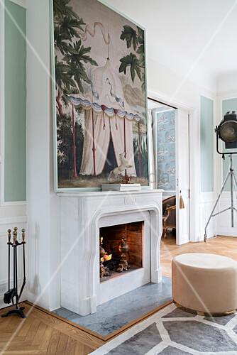 Pouffe in front of fireplace below large art print