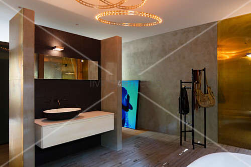 Modern, luxury bathroom with concrete walls