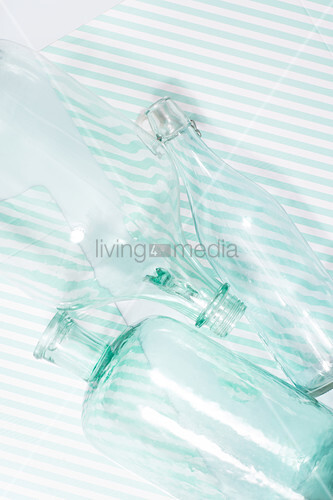 Glass bottles on striped surface