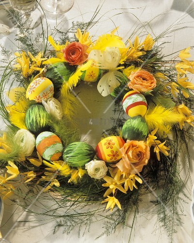 Easter wreath with grasses & coloured eggs for Easter table