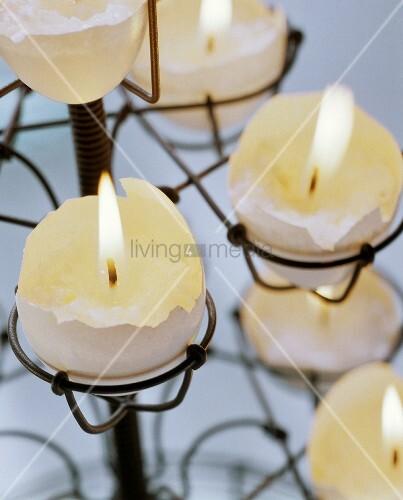 Egg candles: tea lights in halved egg shells