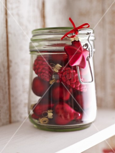 Christmas tree ornaments in storage jar