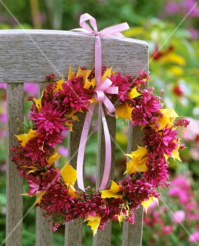 Wreath of chrysanthemums, heather and maple leaves