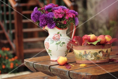 Still life with apples and jug of flowers