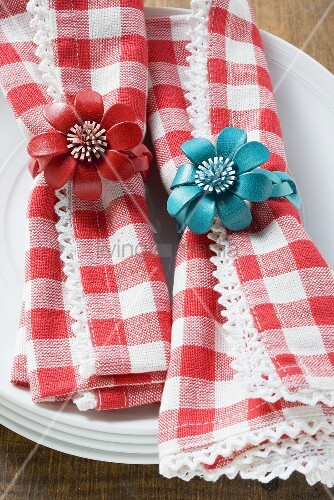 Red and white checked napkins with napkin rings
