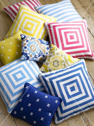 Assorted cushions on wooden floor