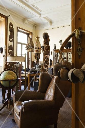 A view through an open door onto an African art collection in a study